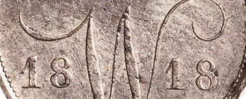Een Nederlands 10ct muntje ook wel dubbeltje genoemd daterende uit het jaar 1818